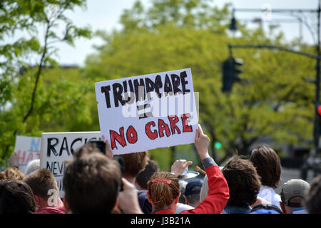 New York City, USA. 4th May, 2017. People protesting Donald Trump's first visit to New York City as President. Credit: - Stock Photo