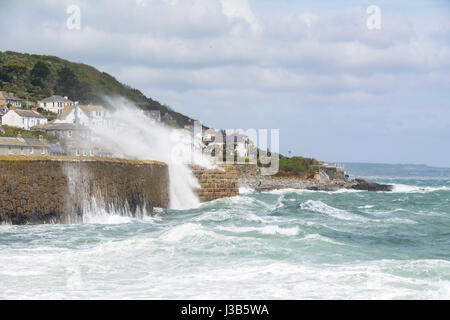Mousehole, Cornwall, UK. 5th May 2017. UK Weather. Strong easterly winds are hitting the Cornwall coast this afternoon, - Stock Photo