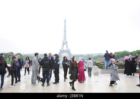 Paris, France. 05th May, 2017. French police officers check two men during patrol near the Eiffel Tower on May 5, 2017 as part of the 'Sentinelle' security plan in Paris, France. Credit: VWPics/Alamy Live News Stock Photo
