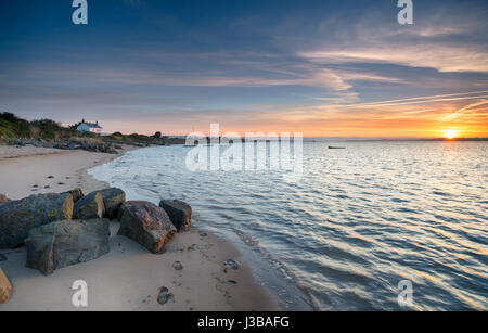 Beautiful sunrise over the beach at Crow Point near Barnstaple on the north coast of Devon - Stock Photo
