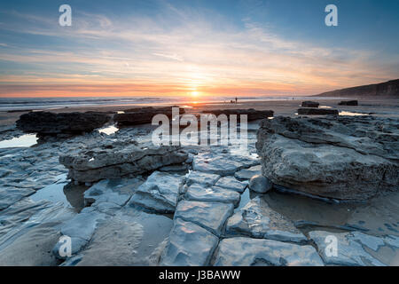 Stunning sunset over Dunraven Bay in the Vale of Glamorgan on the Welsh coast - Stock Photo