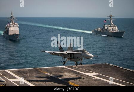 A U.S. Navy F/A-18E Super Hornet fighter from the Kestrels of Strike Fighter Squadron 137 lands on the flight deck - Stock Photo