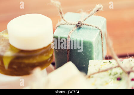 close up of handmade soap bars on wood - Stock Photo