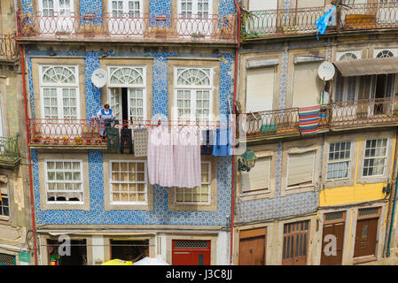 Porto Portugal street, detail of the upper stories of an apartment building decorated with blue azulejos tiles in - Stock Photo