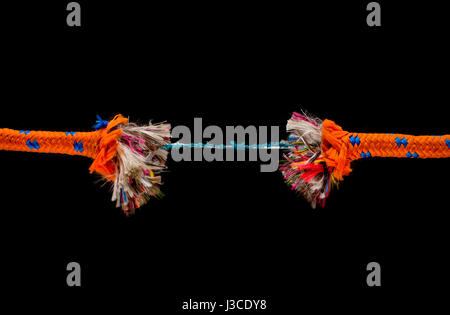 Broken old string - risk and adversity concept - Stock Photo