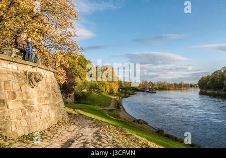 Elder couple in a Autumn landscape at the shores of the Elbe River near Dresden, Saxony, Germany | Älteres Pärchen - Stock Photo