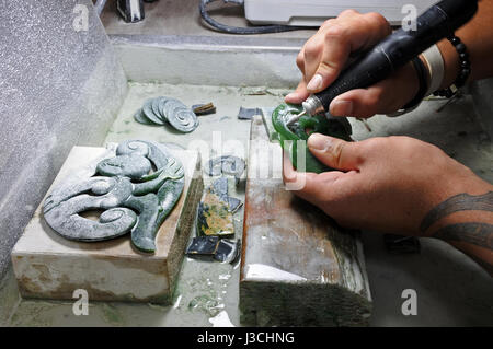 ROTORUA, NZL - APR 24 2017:Hands of a Jade ornamental green rock carver at work. New Zealand Jade protected under - Stock Photo