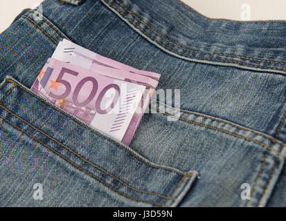 Five hundred Euro banknote in the pocket of blue Jean - Stock Photo