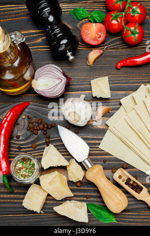 uncooked lasagna pasta sheets and ingridients - Stock Photo
