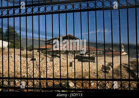 Black wrought-iron fence and construction work on site of the Saint Panteleimon church and monastery in the town - Stock Photo