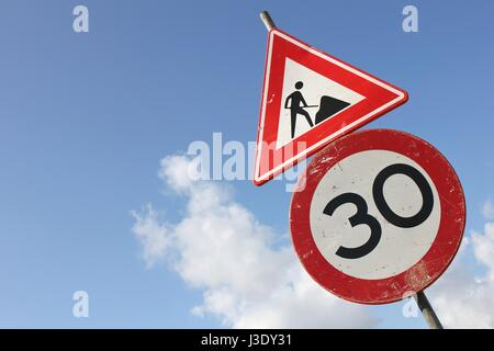 Dutch road sign: speed limit 30 km / h in combination with roadworks ahead - Stock Photo