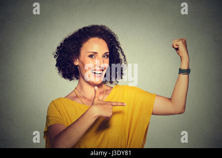 Closeup portrait fit middle aged healthy model woman flexing muscles confident showing her strength isolated on - Stock Photo