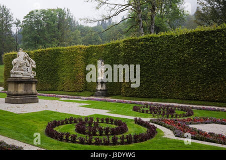 Sculptures in the parterre of a formal garden at the Linderhof palace in late summer, Bavaria, Germany, Europe. - Stock Photo