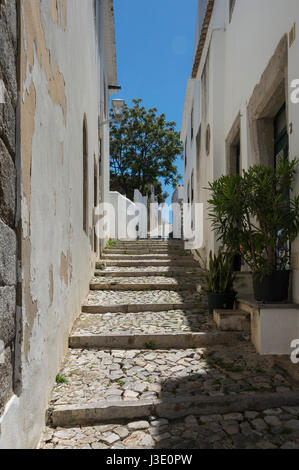 alleyway with cobbled steps in Tavira, Algarve, Portugal - Stock Photo