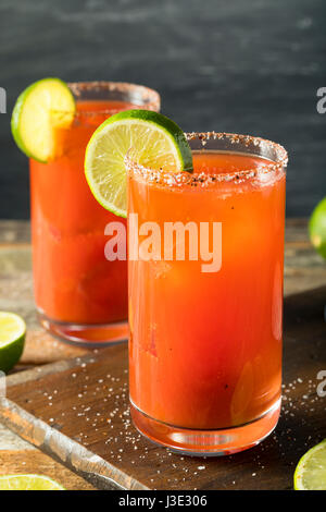 Homemade Michelada with Beer Salted Rim and Tomato Juice - Stock Photo