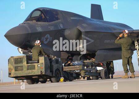 U.S. Marine soldiers conduct a hot load on a USMC F-35B Lightning II stealth fighter aircraft at the Marine Corps - Stock Photo