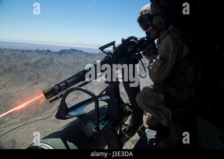 US Marine firing GAU-17 Minigun Marine Corps UH-1N ...