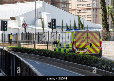 Police van stopped at traffic lights in Gibraltar - Stock Photo