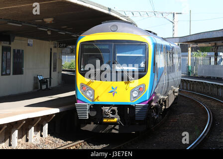 Class 185 Desiro diesel multiple unit in the new First TransPennine livery at Carnforth railway station with a service - Stock Photo