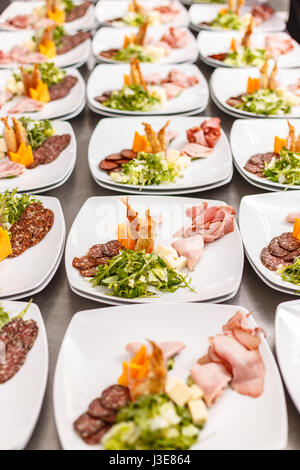 lot of appetizer plates being prepared in commercial kitchen stock photo - Horderves Plates