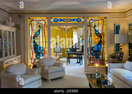 The living room at Elvis Presley's house Graceland in Memphis, Tennessee - Stock Photo