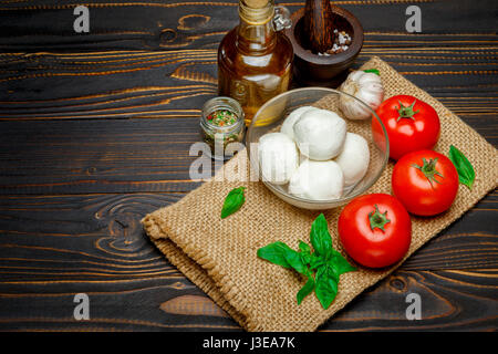 Caprese salad ingridients - Mozzarella and tomato - Stock Photo