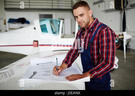 Handsome Jet Mechanic - Stock Photo