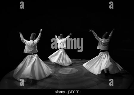 Black and White Dervishes twirling - Stock Photo