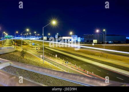 Construction of a road, roadside construction site at night, Roe Highway, Western Australia, Perth, Australia - Stock Photo