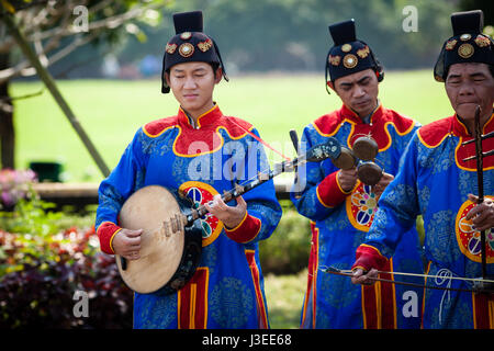 Hoi An, Vietnam - march 10 2017: vietnamese traditional music band is giving concert in Imperial Citadel. Musician - Stock Photo