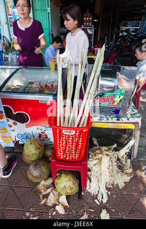 Hoi An, Vietnam - march 10 2017: production of cane juice. This popular refreshing drink can be bought on almost - Stock Photo