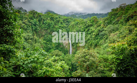 Wide angle view of La Fortuna de San Carlos waterfall in Arenal volcano national park, Costa Rica - Stock Photo