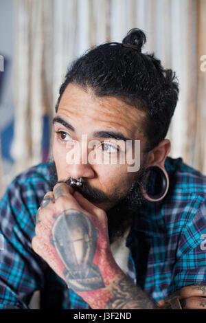 Heavily tattooed man - Stock Photo