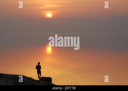 Sunset over the Dead Sea at Wadi Mujib, Jordan, Middle East looking over to Israel and Gaza. Floating, swimming, - Stock Photo
