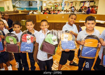 Miami Florida Comstock Elementary School Welcome Back Back Pack Giveaway Hispanic Black boy boys student child children - Stock Photo