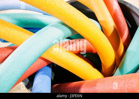 Miami Beach Florida Flamingo Park styrofoam floats pool noodles color shape - Stock Photo