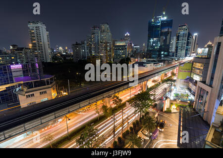Scenic view of skyscrapers and Sukhumvit Road in downtown Bangkok, Thailand, at night from above. - Stock Photo