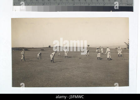 Fig 8  Thirty or more players (15 or more on each side) with a bat and ball playing Town Ball, some times called - Stock Photo