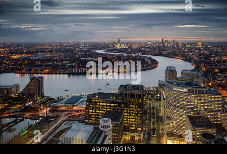 London, England, February 27, 2015: The River Thames meanders through the cityscape of East London as seen from - Stock Photo