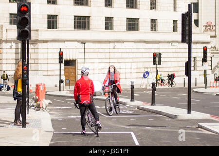 London, England - April 30, 2016: Cyclists using the newly completed segregated North-south Cycle Superhighway, CS6, at Blackfriars Bridge.