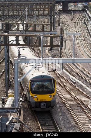 London, England - May 1, 2016: A Heathrow Connect Class 360 electric passenger train crosses track points on the - Stock Photo