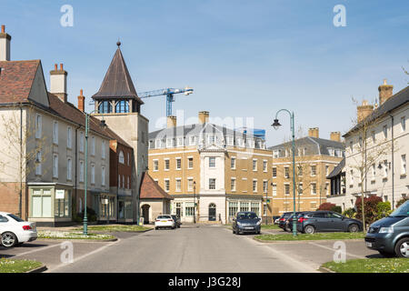 Dorchester, England, UK - May 7, 2016 - Completed streets of new houses and apartment buildings in Poundbury, Prince - Stock Photo