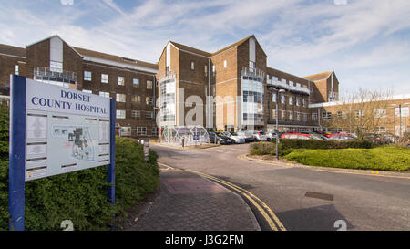 Dorchester, England, UK - May 7, 2016 - The entrance and buildings of Dorset County Hospital, a small regional hospital - Stock Photo