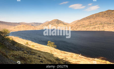 Loch Treig reservoir under mountains of the Nevis massif in the West Highlands of Scotland, as viewed from the West - Stock Photo