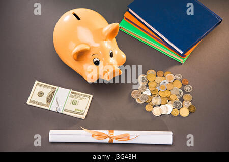diploma, books and piggy bank with coins and dollars on grey, education concept - Stock Photo