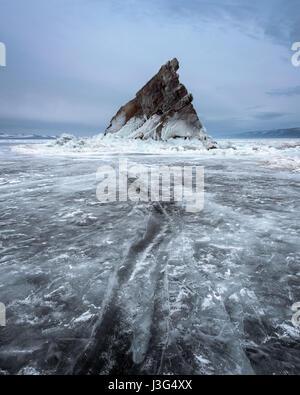 Baikal Lake Ice and Island Elenka in the Morning, Baikal Lake, Russia - Stock Photo