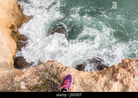 Woman Foot standing on cliff edge over sea. Travel Lifestyle concept Summer vacations - Stock Photo