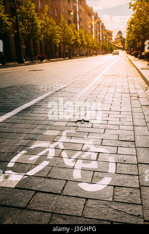 Bycycle Road Sign, Road Marking Of Bicycle Path Along Avenue Or Street In City In A Sunny Morning Or Evening At - Stock Photo