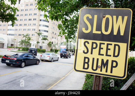 Miami Beach Florida Mt. Mount Sinai Medical Center hospital sign slow speed bump cars drive warning traffic safety - Stock Photo