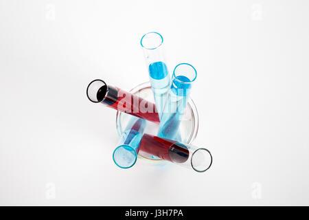 Chemistry glassware with colored liquid - Stock Photo